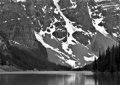 IN YO FACE (Rob Patzke) Tags: scenery mountain bw monochrome landscape water lake reflection tree snow ice panasonic lumix lx100 canada rock boulder stone steep
