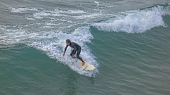 Another Winter Surfer (Viejito) Tags: pismobeach california slo county usa unitedstates geotagged geo:lat=35138101 geo:lon=12064544 amerika amérique américa america canon powershot s100 canons100 waterfront beach playa praia sea pacific ocean pier pacificocean surf surfer froth barefoot босиком piedsnus descalzo scalzo descalço bare feet toes face zee oceaan surfing waves watersports golf vague océan oceano onda blue white spume water wave black glistening wet suit pyzel surfboard vissla wetsuit man open mouth bouchebée agape awe facial expression