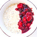 Top view of oat porridge with berry compote