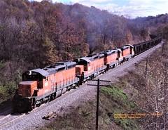 BLE 856-847-827-855, N. Butler, PA. 10-29-1990 (jackdk) Tags: train railroad railway locomotive emd emdsd9 emdsd18 sd9 sd18 ble bessemer bessemerandlakeerie coal coaltrain coaldrag butler butlerpa northbutlerpa standardcab fallenflag fallcolor fall
