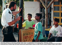 Policeman Warns Boys 01 (hoffman) Tags: asian bangladesh bangladeshi bengali black british britishisles child children community constable control daylight ec eec england english eu europe europeanunion gesture greatbritain horizontal law listening males order outdoors pointing police policeman policing power radio reprimand reprimanding street talking uk uniform unitedkingdom warning young youth davidhoffman wwwhoffmanphotoscom london