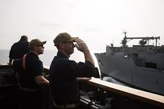 U.S. Navy Capt. Robert Bryans Jr., from Cohohes, New York, salutes to the dry cargo and ammunition ship USNS Charles Drew (T-AKE 10) (NavyOutreach) Tags: guidedmissilecruiser ussmobilebaycg53 ticonderogaclass usn csg3 arabiangulf us