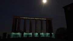 Message From the Skies 05 (byronv2) Tags: edinburgh edimbourg edinburghbynight night nuit dusk nacht scotland caltonhill newtown nationalmonument architecture building neoclassical monument classical classicalarchitecture projection soundandlight sonetlumiere messagefromtheskies europe proeurope kapkakassabova hill moon