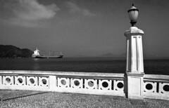 Ponta da Praia (Manuel Goncalves) Tags: santos pontadapraia beach ship blackandwhite 35mmfilm nikonn90s sigma24mm rolleiretro400s analogue canal port epsonv500scanner