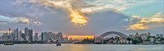 Burning under covers (JustAddVignette) Tags: australia city cityscape clouds glow harbourbridge landscapes newsouthwales ocean panorama reflections seascape seawater sky sunset sydney sydneycbd water