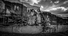 Coal Miner Mural (Bob G. Bell) Tags: mural coalminer coal coalminers building history historic richwood wv bobbell blackandwhite bw sky brick painting