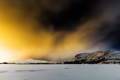 Blizzard closing in - Mosfellsbær, Iceland (Páll Guðjónsson) Tags: hafravatn iceland mosfellsbaer blizzard citylights clouds dramatic frozen lake landscape mountains snow spectaciluar stars winter weather