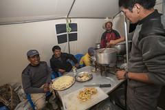 Pizza coming up! (Jamie @project-himalaya.com) Tags: projecthimalaya 2007 2007shishapangma 2007shishapangmaexpedition canoneos5d dageljesherpa dawadageljesherpa ef1635mmf28lusm karsangtibetan copyrightjamiemcguinness httpprojecthimalayacom shishapangma xizangtibet china