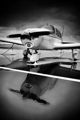 Winter Cherokee Reflection (Never Exceed Speed) Tags: blackandwhite machinery colorado lovelandftcollinsairport airport aircraft airplane reflection cherokee140 snow winter
