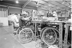 disabled man in factory (hoffman) Tags: horizontal disability handicap transport wheelchair work factory industry employment mentmore british health infirmity uk unitedkingdom affliction disabled disablement disadvantage handicapped impairment impediment incapacitated incapacity davidhoffman wwwhoffmanphotoscom london