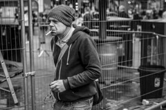 Unlit (Leanne Boulton) Tags: urban street candid portrait portraiture streetphotography candidstreetphotography candidportrait streetportrait streetlife man male face expression mood feeling emotion smoke smoker smoking cigarette beanie cold winter weather fence tone texture detail depthoffield bokeh naturallight outdoor light shade city scene human life living humanity society culture lifestyle people canon canon5dmkiii 70mm ef2470mmf28liiusm black white blackwhite bw mono blackandwhite monochrome glasgow scotland uk