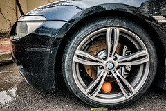Prank (Melissa Maples) Tags: antalya turkey türkiye asia 土耳其 apple iphone iphonex cameraphone winter street rain puddle water bmw fruit orange rim vehicle automobile wheel car