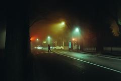 Passeggiate notturne (matteoguidetti) Tags: fog foggy mood nebbia nocturnal nightwalk nightwalker city urban lights trafficlight colors greenlight redlight man walking street strada notturno città