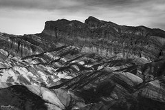 Study of Contrast at Zabriske Point (NormFox) Tags: america bw bnw badlands blackandwhite blackandwhiteartistry california canyon clouds contrast deathvalley desert dry enviornment geology landscape mojave monochrome mountains national naturalbeauty nature outdoors park photography remote rocks rugged sandstone senic sky usa valley zabriske hike ridge unitedstatesofamerica us