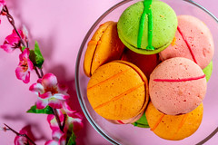 Sweet multicolored macarons on pink background. (wuestenigel) Tags: sugar cake dessert flowers sweet food confectionery cream background snack pastel colorful biscuit flavor delicious macaron macaroons cookie pink assorted macaroon macarons green candy yellow pastry paper noperson keineperson süss lebensmittel fruit obst köstlich color farbe zucker süsigkeiten confection konfekt sahne summer sommer chocolate schokolade easter ostern refreshment erfrischung vanilla vanille kuchen stilllife stillleben relish geniesen apple apfel desktop