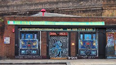 Abandoned wine shop, Kingsland Road, Shoreditch, London E2. (edk7) Tags: olympusomdem5 edk7 2018 uk england london londone2 londonboroughoftowerhamlets shoreditch kingslandroad architecture building oldstructure crusty crust wall brick wineshop vacant abandoned graffiti wallart mural city cityscape urban artmushroom redartmushroomsculpturechristiaannagelexpandingpolyurethanefoamc2012 sidewalk unicorn word sign signage texture