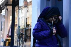 Lighting Up Time (Bury Gardener) Tags: burystedmunds suffolk england eastanglia uk streetphotography street streetcandids snaps strangers candid candids people peoplewatching folks 2018 nikond7200 nikon e abbeygatestreet