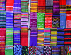 Colorful textile for sale at street market (phuong.sg@gmail.com) Tags: asia asian assortment bazaar bright business cashmere cloth clothing colorful colors concept consumerism couture design different drapery fabric fashion goods hanging industry many market multicolored myanmar palette range retail row sale samples scarves sell shawl shop store street style textile thailand trade vibrant