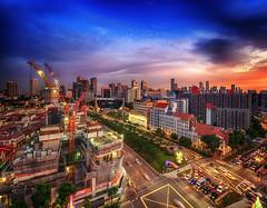Urban sundown (Rexer Ong) Tags: cityscape sundown traffic construction urban road orange
