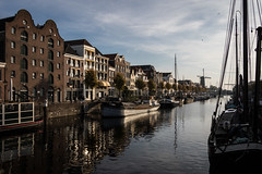 Delfshaven, Rotterdam (Adrià Páez) Tags: delfshaven rotterdam architecture windmill buildings boats water canal city zuidholland southholland holland nederland the netherlands europe canon eos 7d mark ii sky clouds