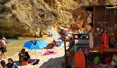 (trailrunner55) Tags: lagos portugal travel europe shack beachumbrella manwithcamera bikini swimsuit