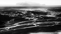 Distant Hill (azhukau) Tags: nature sea landscape blackandwhite scenics water outdoors beautyinnature nopeople iceland rockobject coastline coldtemperature geology sky monochrome hill mountain