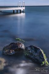 Two rocks and a pier. (PvRFotografie) Tags: nederland holland nature natuur water rocks steen stenen steiger pier blue blauw wideangle grevelingen lake sea sonyilca99m2 1224mm sigma1224mm sigma12244556 sigma1224mmf4556dgiihsm leesw150 leesuperstopper triggertrap longexposure