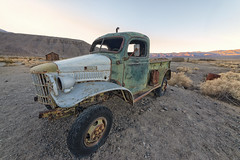 Desert Transportation (magnetic_red) Tags: rusted rust rusty desert abandoned junk vehicle deathvalley mountains sunrise morning dodge powerwagon truck green