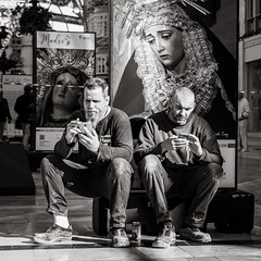 having a break (Gerard Koopen) Tags: spanje spain espana malaga city urban people man woman poster madre outfit straat street straatfotografie streetphotography streetlife bw blackandwhite blackandwhiteonly sony sonyalpha a7iii 2018 gerardkoopen gerardkoopenphotography