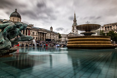 Across the square (Through_Urizen) Tags: architecture category citiestowns england london longexposure places trafalgarsquare travel canon canon1585mm canon70d city capitalcity uk greatbritain unitedkingdom nationalportraitgallery stmartininthefield fountain water clouds cloudysky motionblur tourists tourism landmarks sky
