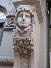 Woman with High Collar Gargoyle Next to Door Way 4686 (Brechtbug) Tags: woman with high collar gargoyle above door front exterior building entrance new york city near 9th ave west 21st street nyc 2018 gargoyles statue sculpture man portrait art downtown stone terracotta tile artist portraits 20s area w women slope low nose