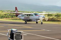 Taxi! (gooey_lewy) Tags: aircraft hawaii hawaiian islands aviation plane transport blur propeller island engine single hopping airport kapalua maui n852ma caravan grand cessna mokulele spirit