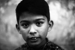 A Hint Of A Toothy Grin (N A Y E E M) Tags: boy neighbour portrait friday afternoon street rabiarahmanlane chittagong bangladesh carwindow