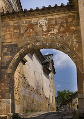 Old Gate At Tuan Shan Village, Yunnan Province, China (Eric Lafforgue) Tags: 3people a0006442 architecture asia carving china chineseculture colorpicture door entrance gate history house old outdoors realpeople threepeople threepersons traditionalculture vertical yunnan yunnanprovince tuanshan