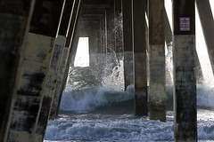 Splash (ramseybuckeye) Tags: under pier wrightsville beach wilmington north carolina ocean water splash waves surf concrete pillars