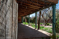 Santa Fe Space (lorinleecary) Tags: sculpture trees newmexico building porch woodfence buildings grain garden santafe places otherkeywords