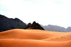 TIRE MARKS IN  THE DESERT IN  FUJAIRAH, UAE. (HILLS AND DYNAMIC BLACK GRANITE PEAKS IN THE DESERT) (vermillion$baby) Tags: desert fujairah granite mountains sand uae