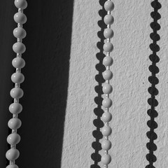 Macro Monday - Center Square B&W (brittajohansson) Tags: macromonday centersquare blackandwhite bw macro monday beaded pullcord rollerblind shadow shadows beads rollerchain chain blinds minimal abstract abstractreality black white square
