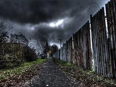 Dark path (Ostravak83) Tags: ostrava vítkovice nikoncoolpixp1000 p1000 ultrazoom hdr vysokýdynamickýrozsah cesta path mraky clouds temnota darkness zima winter november listopad mráz frost obloha sky hřbitov cemetery graveyard burialgrounds 2018