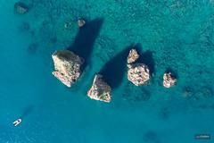 Floating on an emerald sea (lucasodano) Tags: mavic dji drone aerial birdseye rocks sea boat vessel yacht shadows deep summer