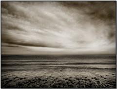 Drifting Beach | Løkken, Denmark (Flemming J. Gade) Tags: sea northsea bw beach sand wind clouds ocean water
