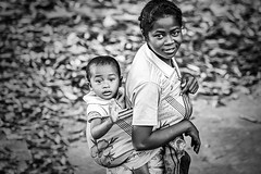 Along the train (B&W) (Photox0906) Tags: madagascar woman mother child baby back holding carry africa malagasy childhood outside countryside boy outdoors people family cute little togetherness joy happiness two smile portrait lifestyle love walking carrying