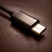 USB Type-C cable on leather background