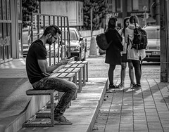 Different ways to communicate..... (Kevin Povenz Thanks for all the views and comments) Tags: 2018 october kevinpovenz bratislava slovakia street streetphotography downtown blackandwhite bw canon7dmarkii male female girl girls boy person bench sitting standing corner talking phone