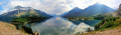 Vimy Peak, Mount Boswell & Upper Waterton Lake with Mount Cleveland in the far Distance, Waterton Lakes National Park, Alberta, Canada (Black Diamond Images) Tags: watertonlakesnationalpark watertonlakes waterton msice vimypeak mountboswell watertonlake mountcleveland westernusatrip2018 canond60 1770 2018 microsoftimagecompositeeditor msicepanorama alberta watertonlakesnationalparkofcanada parcnationalducanadadeslacswaterton canada mountain mountainside water snow clouds reflections landscape tree sky serene upperwatertonlakes lake upperwatertonlake travelalberta albertatravel albertaholiday holidayalberta