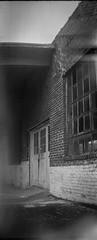 old commercial building, windows, doors, brick, West Asheville, North Carolina, (Eastman Kodak Co. Successor to) Blair Camera No. 7 Wend Hawk Eye, Kodak TriX 400, Ilford Ilfosol 3 developer, 1.17.19 (steve aimone) Tags: oldcommercialbuilding architecture architecturalforms brick doors windows urbandecay urbanlandscape westasheville northcarolina eablaircameracono7wendhawkeye eastmankodak hawkeye kodaktrix400 ilfordilfosol3developer boxcamera 122film 120 120film film mediumformat monochrome monochromatic blackandwhite lightleaks doubleexposure
