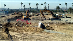 (Rich T. Par) Tags: pomona phillipsranch socal southerncalifornia losangelescounty lacounty constructionsite california palmtrees tree road suburb dirt civilengineering tubes excavator tractor heavyequipment pipes sky watertruck trench backhoe backhoeloader loaderbackhoe digger civilengineers ladder