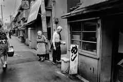 Street corner 640 (soyokazeojisan) Tags: japan osaka city street bw people blackandwhite monochrome analog olympus m1 om1 28mm film trix kodak memories 1970s