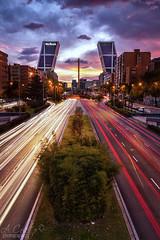 Madrid (A.Coleto) Tags: verde atardecer madrid torres kio plaza castilla españa canon lucroit filtro estelas coches