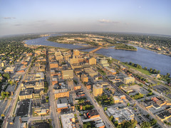 Davenport is a larger city in Iowa on the Mississippi river with Illinois (JacobBoomsma) Tags: architecture photo road landscape town landmark building urban aerial aeriallandscape city blue sunset outdoor davenport water historic downtown dronedji river cityscape travel tourism view dronecamera sky tourist iowa drones summer plane helicopter above dusk low light border